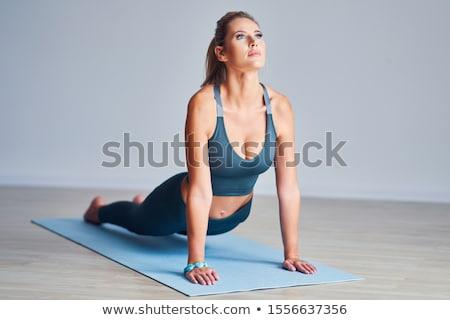 Fit Woman Practising Yoga stock photo © rognar