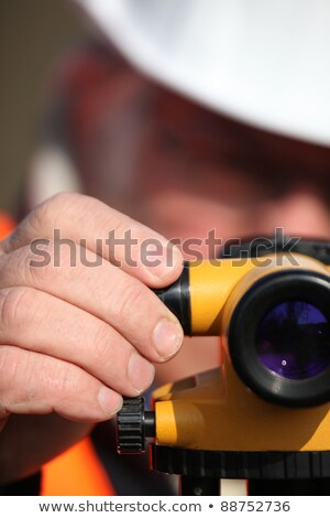 Civil engineer adjusting a theodolite Stock photo © photography33