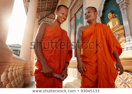 two monks meet and salute in a buddhist monastery asia stock photo © diego_cervo