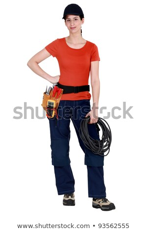 Handywoman holding cabling and wearing a tool belt Stock photo © photography33