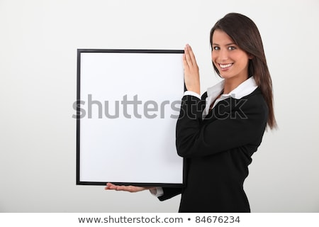 Attractive businesswoman with picture frame Stock photo © photography33