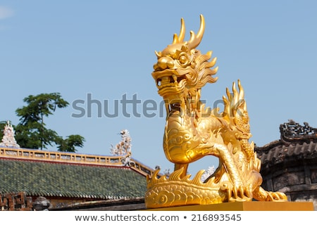 Golden dragon statue in blue sky background stock photo © pinkblue
