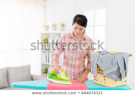 Pretty female housekeeper busy working Stock photo © stockyimages