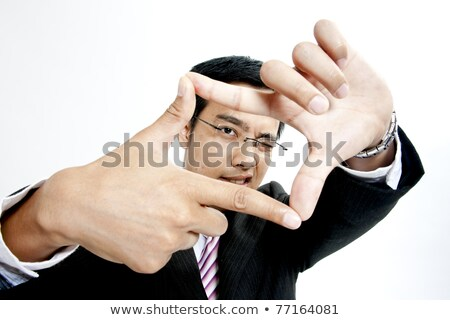 executive making frame with his hands stock photo © feedough