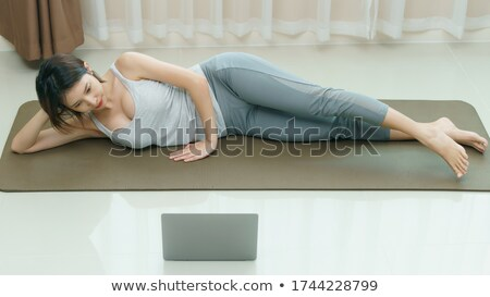 Stock photo: Woman kicking her legs in the air