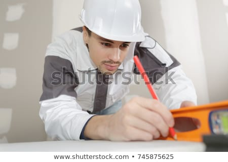 Stock photo: Man making sure wall is straight