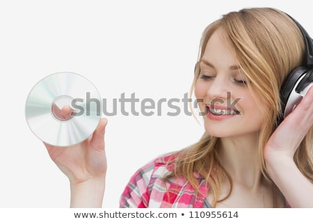 Woman standing while holding a cd against a white background Stock photo © wavebreak_media