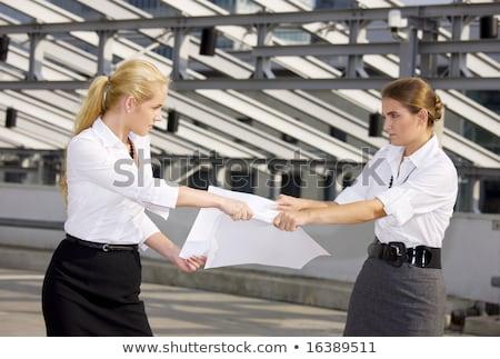 Kettő gyönyörű üzlet lányok iratok harcol Stock fotó © Len44ik