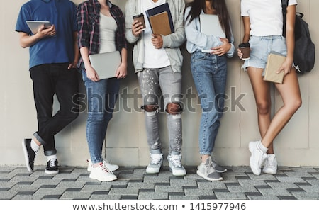 portrait of a mixed race college student at campus leaning wall stock photo © hasloo