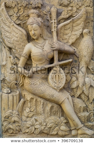 Ancient stone carving in Angkor, Cambodia Stock photo © tommyandone
