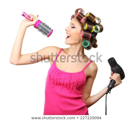 Beautiful woman with a hairdryer and curlers Stock photo © stryjek