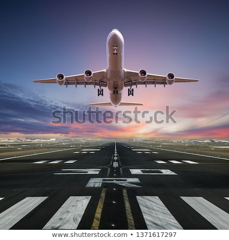 airplane takeoff in sunset stock photo © alptraum