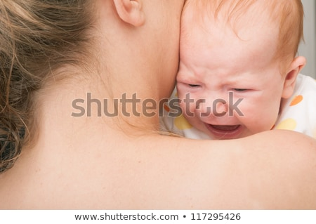 crying baby on mother shoulder Stock photo © Aikon