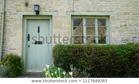 Street view of row of English cottages, Cotswold Stock photo © jayfish