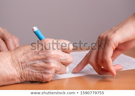Kéz aláírás jogi irat közelkép férfi Stock fotó © frannyanne