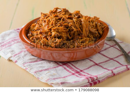 Plate filled with pulled pork on a round dish stock photo © phila54