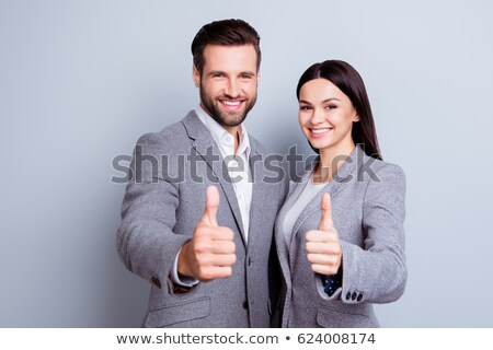 молодые брюнетка женщину борода деловой человек большой палец руки Сток-фото © sebastiangauert