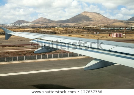 takeoff at airport of lanzarote with volcanoes stock photo © meinzahn