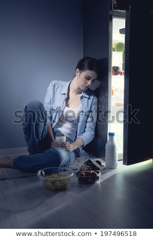 sleepless woman having a glass of milk stock photo © stokkete