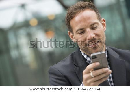 hombre · de · negocios · mirando · hacia · abajo · aislado · mano · hombre · traje - foto stock © filipw