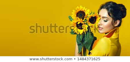 beautiful girl with a sunflower stock photo © nejron