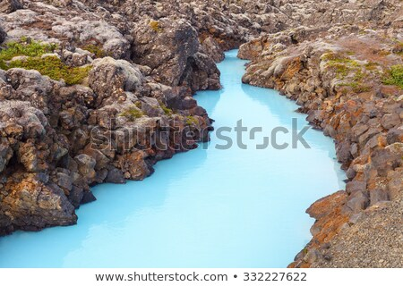The blue water between the lava stones covered with moss  Stock photo © compuinfoto
