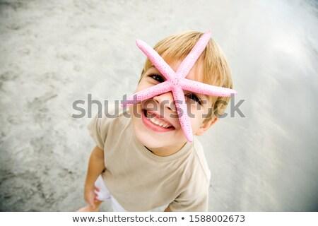 Boy Holding Starfish Found On Beach Stock photo © monkey_business