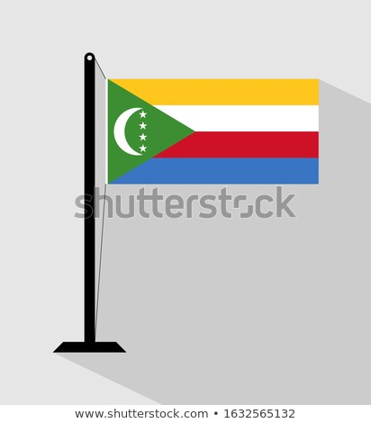 Comoros Small Flag on a Map Background. Stock photo © tashatuvango