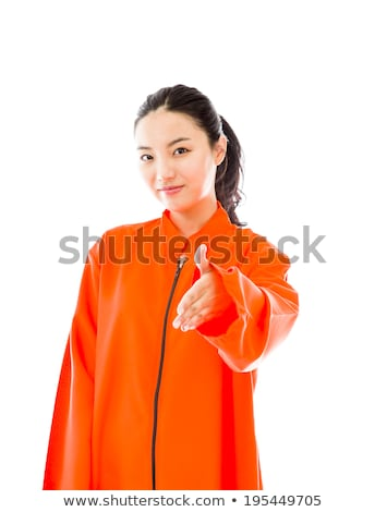 Stock foto: Young Asian Woman Offering Hand For Handshake In Prisoners Uniform