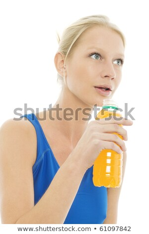 woman wearing a sports blue vest and drinks a bottle of energy drinks stock photo © ambro