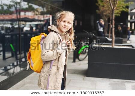 Young schoolgirl standing watching and waiting Stock photo © stryjek