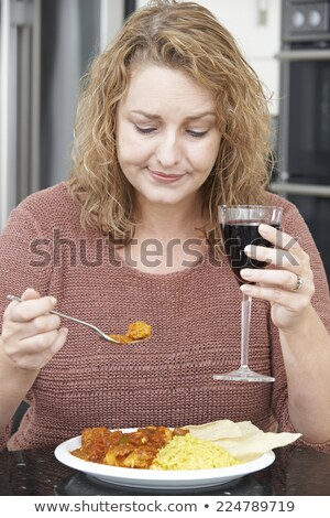 Suçlu kadın yeme köri içme şarap Stok fotoğraf © HighwayStarz