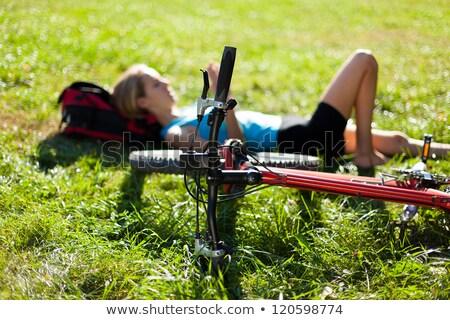 Fiatal kerékpáros pihenés fű friss zöld fű Stock fotó © id7100