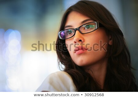 Closeup portrait of a young thoughtful woman in glasses  Stock photo © deandrobot
