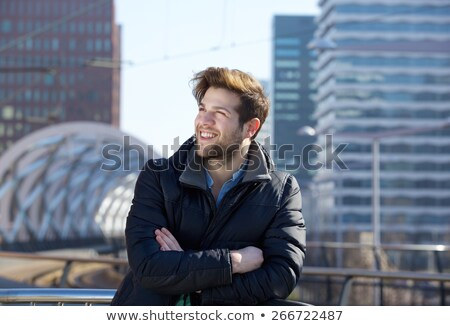 Young Fit Man Standing in a Building Looking up Stock photo © stryjek
