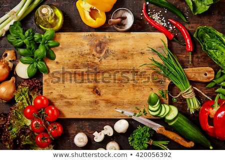 Knives on Cutting Board with Chopped Veggies Stock photo © ozgur
