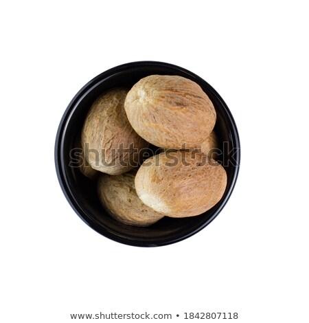 Organisch nootmuskaat zaad keramische kom witte Stockfoto © ziprashantzi