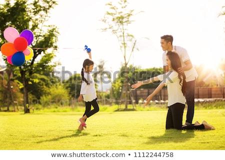 mãe · filha · parque · mentir · grama · primavera - foto stock © paha_l