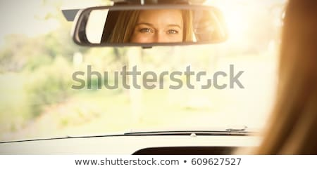 woman looks to rear view mirror stock photo © ssuaphoto