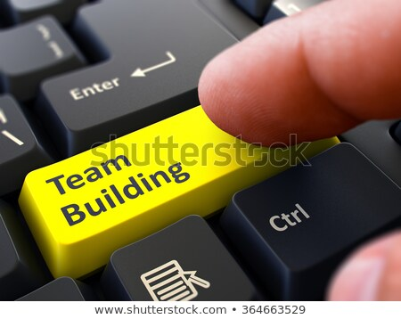 Finger Presses Yellow Keyboard Button Team Building. Stock photo © tashatuvango