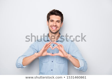 Handsome man with gentle smile stock photo © filipw