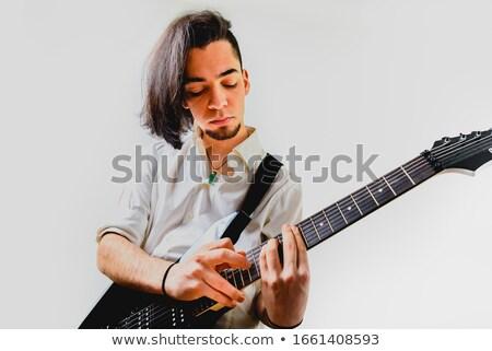 Excité élégant jeune homme cheveux longs jouer guitare acoustique Photo stock © deandrobot