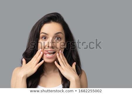 Cute женщину темно длинные волосы прикасаться лице Сток-фото © deandrobot