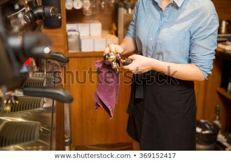 Kadın temizlik espresso makine Stok fotoğraf © dolgachov