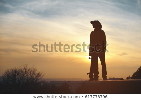 boys with skateboarders at sunset Stock photo © adrenalina