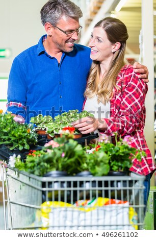 Clerk attending customer in garden center  Stock photo © Kzenon