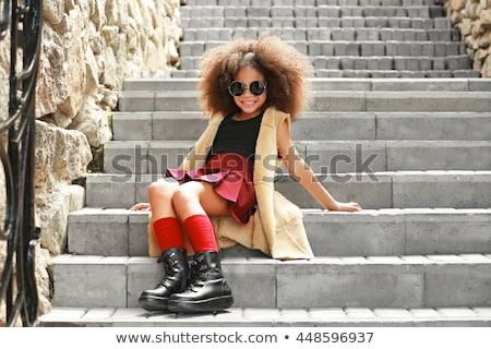 Bella giovane ragazza posa passi città Foto d'archivio © artfotodima