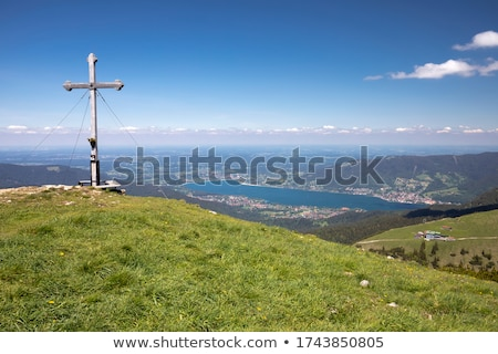 View to a summit cross in Bavarian Alps Stock photo © kb-photodesign