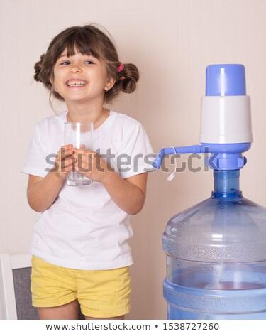 Baby girl with large water bottle Stock photo © ilona75