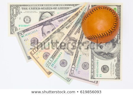 Foto d'archivio: Leather Baseball Ball And Us Money On The White Table
